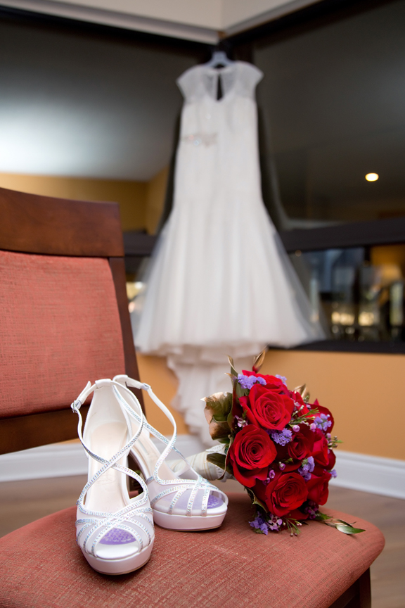 bride prep wedding shoes and flowers