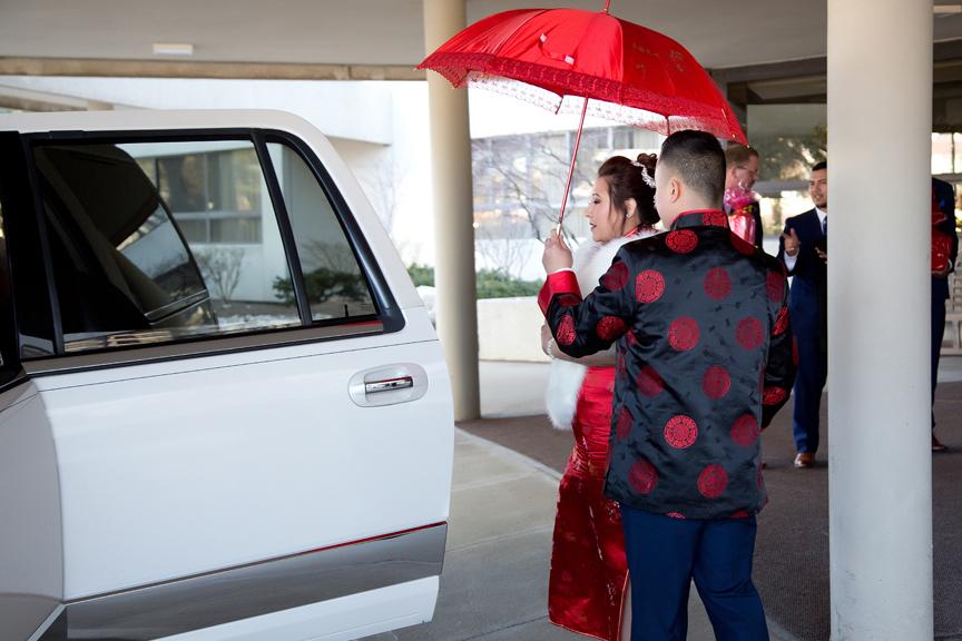 bride and groom leaving hotel