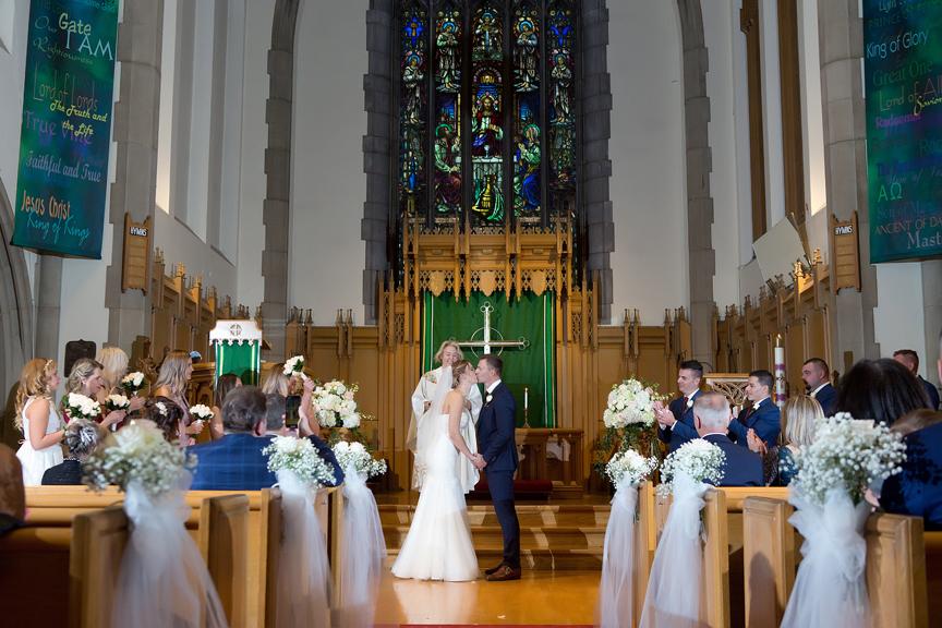 Wedding couple's first kiss at Islington United Church