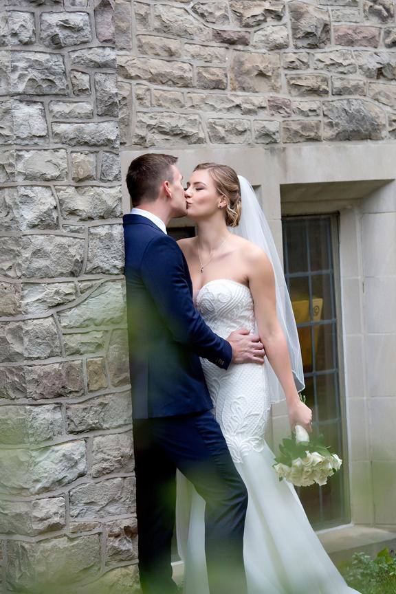 Wedding couple kissing at Islington United Church