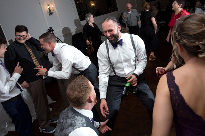 Best man dancing at Le Treport Wedding & Convention Centre