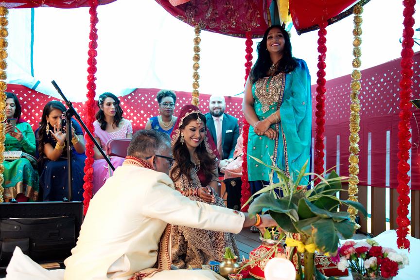 bride prayer Hindu ceremony backyard wedding