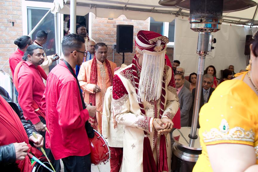 groom arrives Hindu ceremony backyard wedding