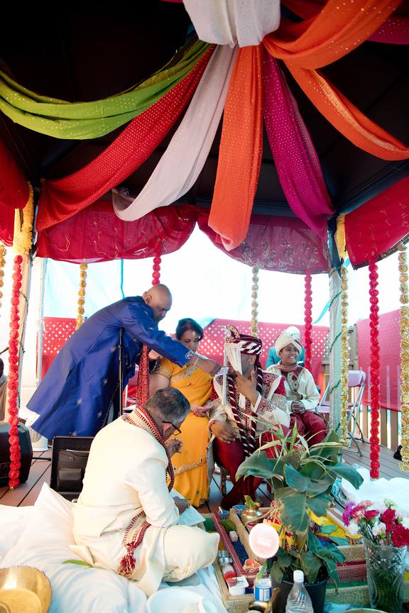 groom's prayer Hindu ceremony backyard wedding