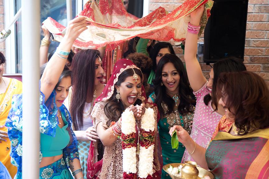 bride arrives at Hindu ceremony backyard wedding