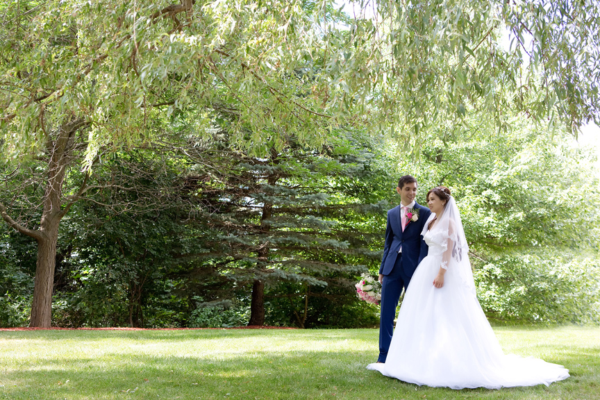 bride and groom walking at Carl Catering The Glen