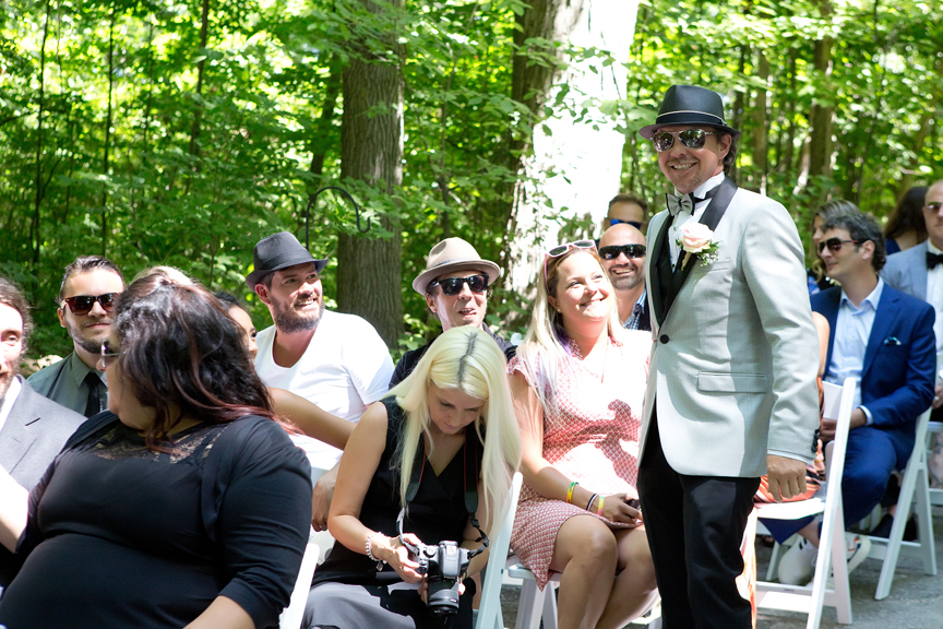 groom mingling wedding ceremony at Kortright Centre for Conservation