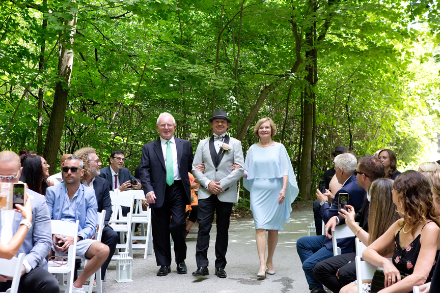 groom walks down the isle wedding ceremony at Kortright Centre for Conservation
