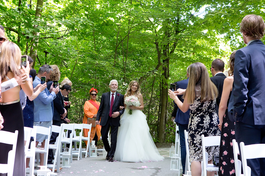 bride walks down the aisle wedding ceremony at Kortright Centre for Conservation