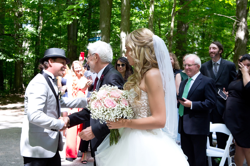 bride walks down the aisle at Kortright Centre for Conservation