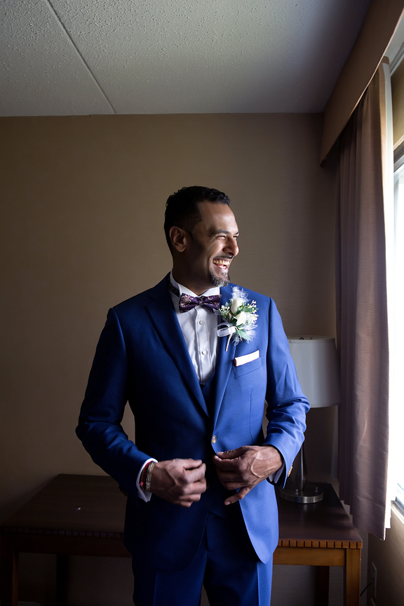 groom prep portrait