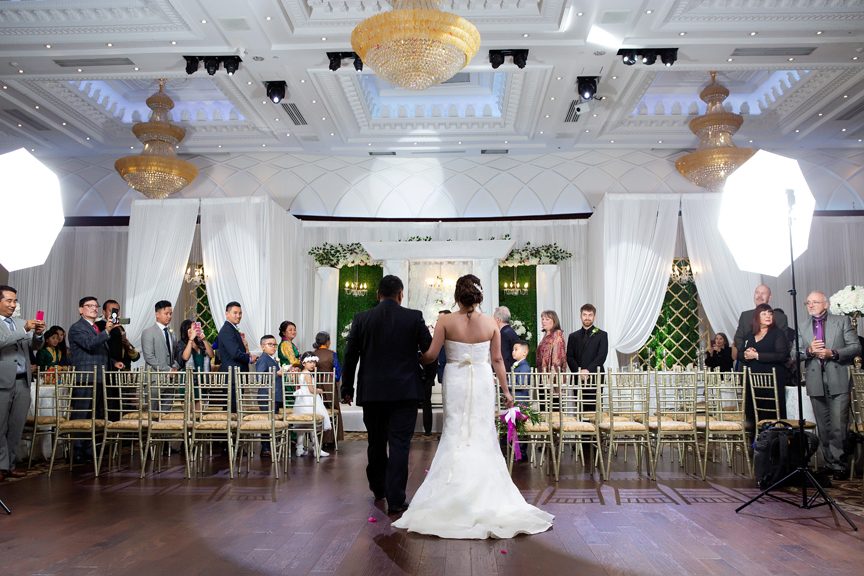 walking down the isle at Grand Empire Banquet And Convention Centre