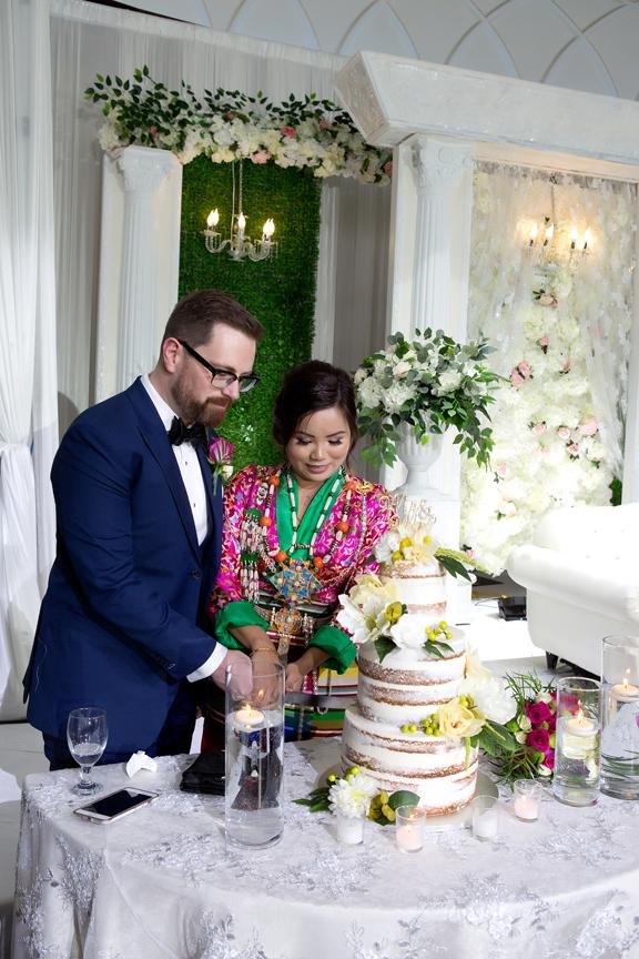 cake cutting at Buddhist Wedding