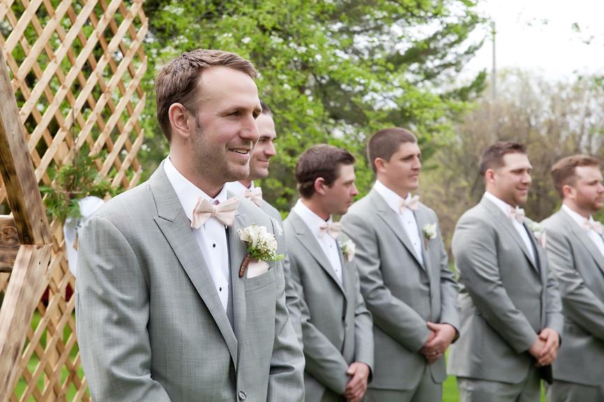 groom's first look backyard wedding ceremony