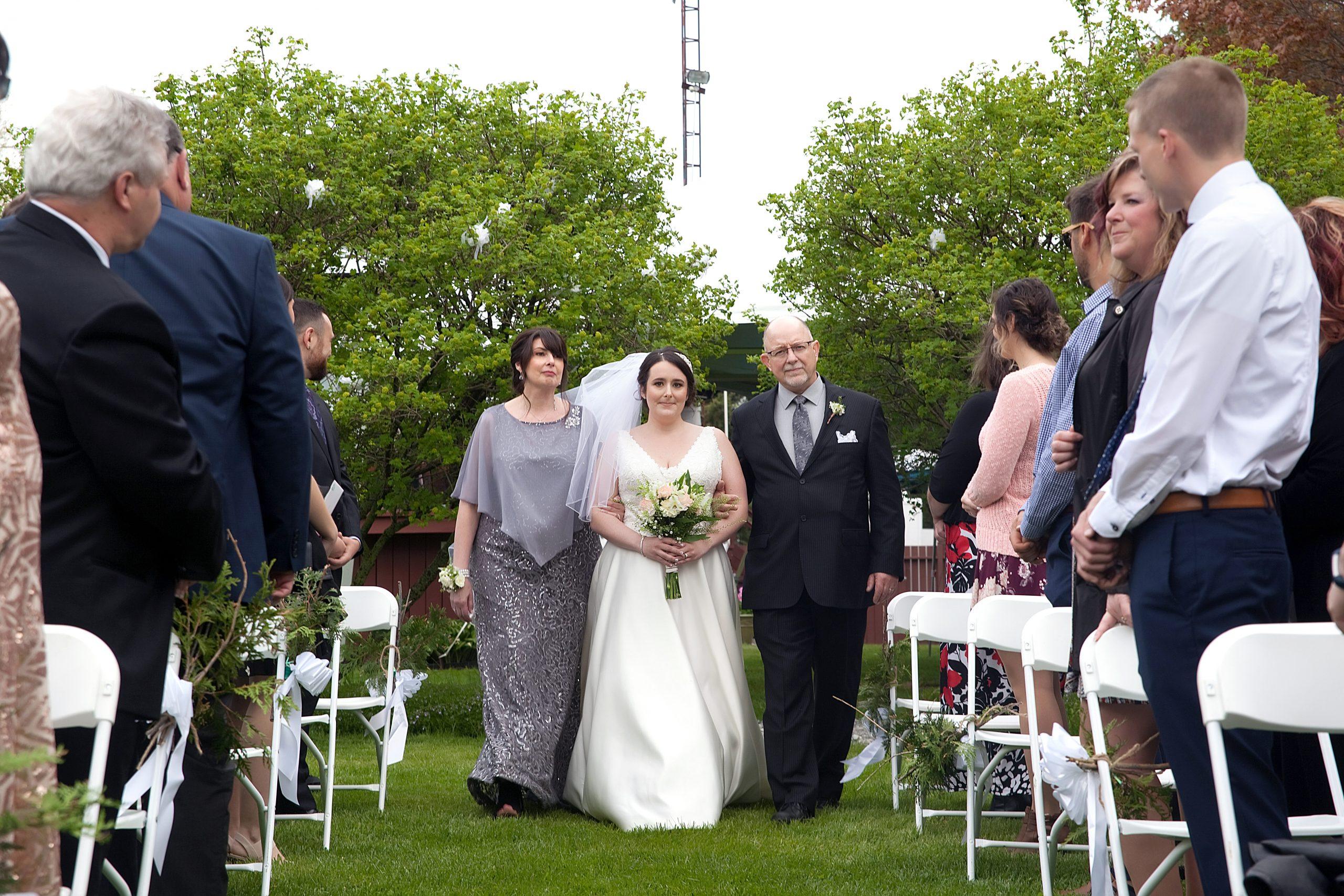 bride down the aisle backyard wedding ceremony