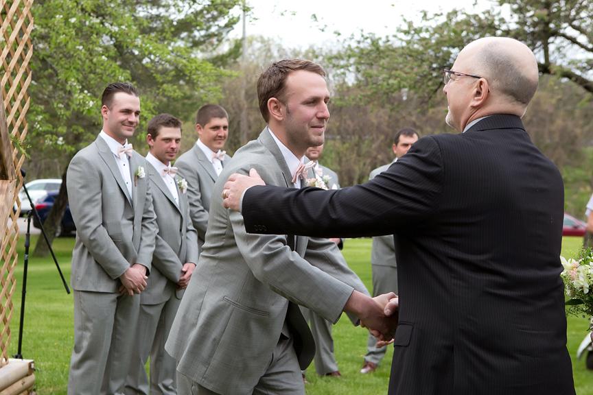 giving the bride away backyard wedding ceremony
