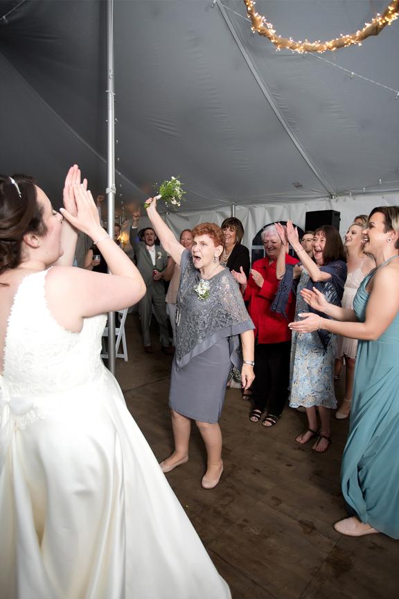 Backyard Wedding wedding reception bouquet toss
