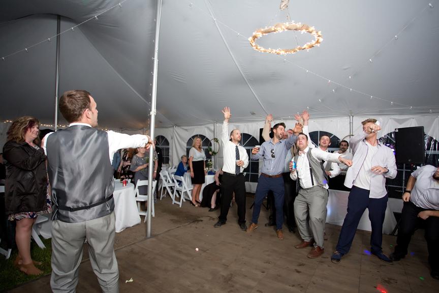Backyard Wedding wedding reception garter toss