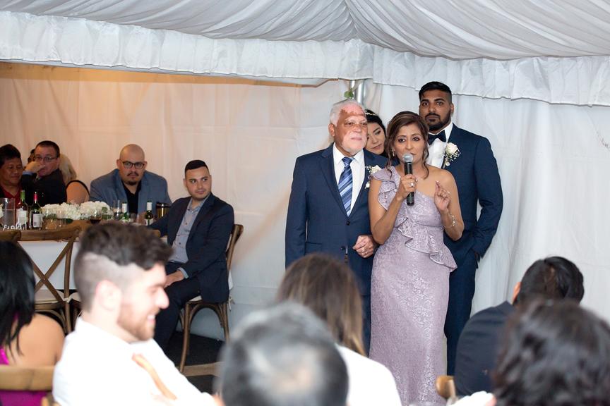 groom's parent speech in backyard wedding