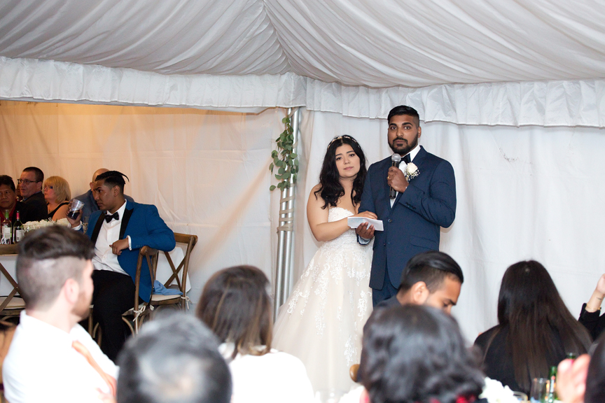 couple speech in backyard wedding