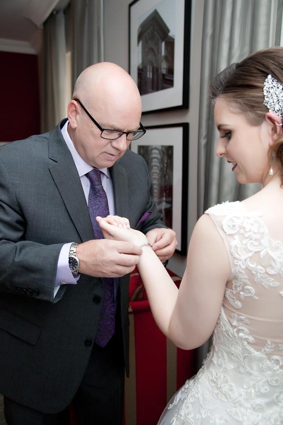 bride prep with dad
