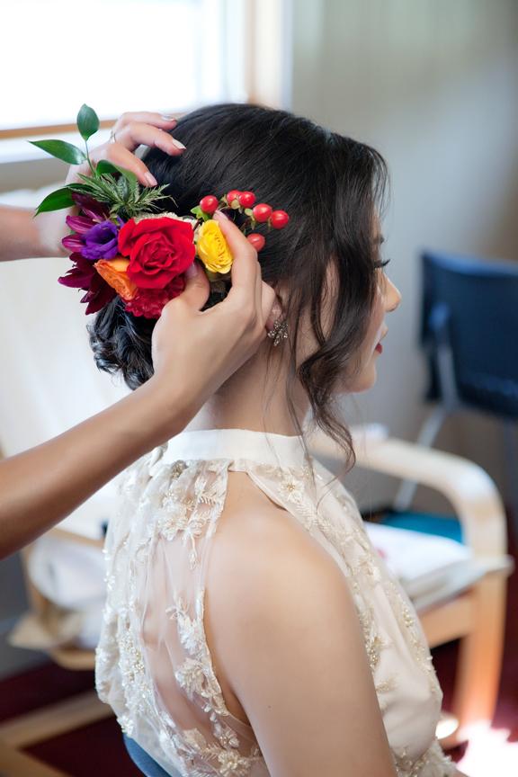 bride prep flowers in hair