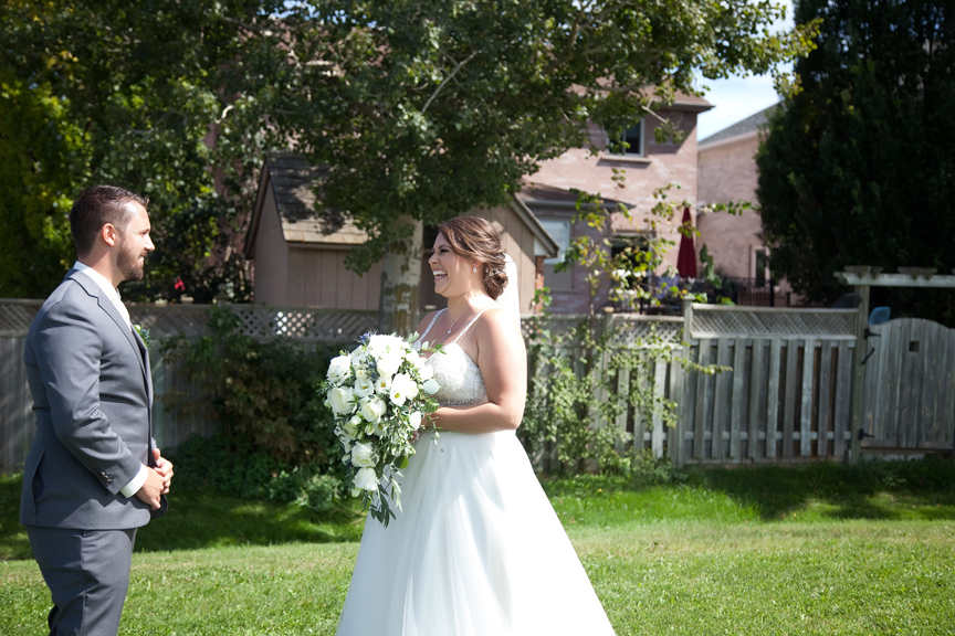 wedding couple's first look at George Richardson Park