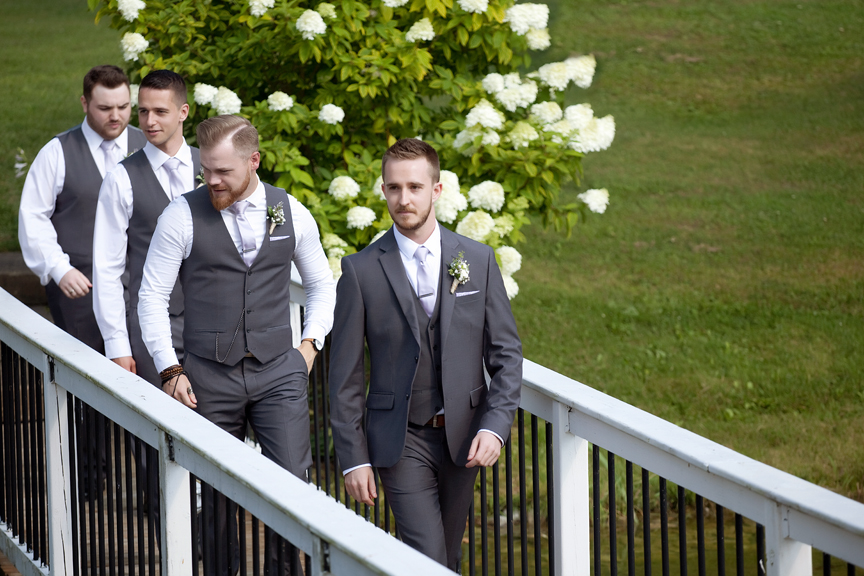 groomsmen down the aisle wedding ceremony at Trillium Trails Banquet Centre
