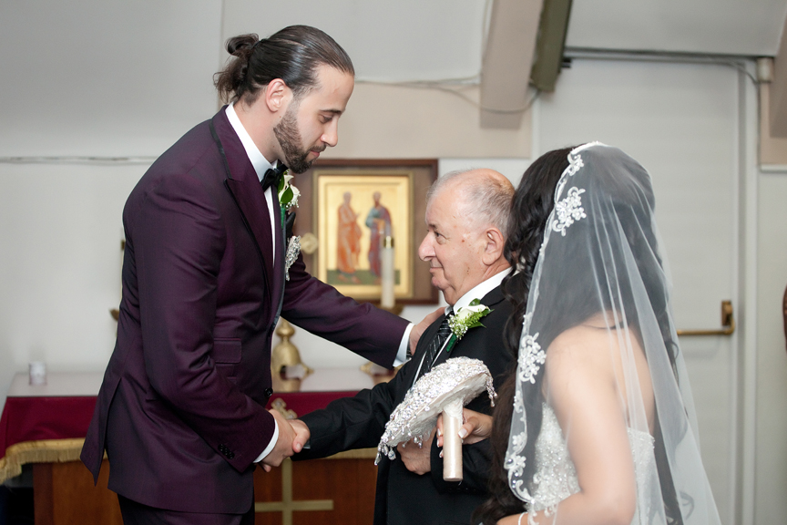 father giving away the bride wedding ceremony at All Saints Greek Orthodox Church