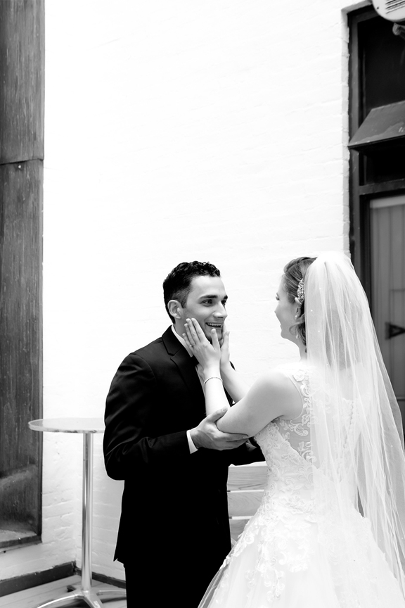 bride and groom first look at Rosewater Room
