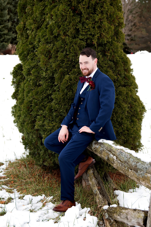 groom portrait winter wedding at Waterstone Estate and Farms