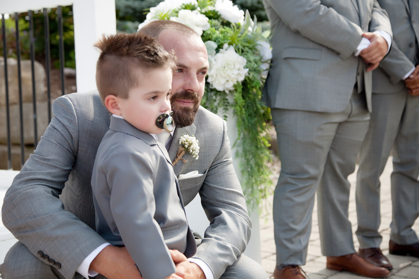 groom and son wedding ceremony at Tangle Creek Golf and Country Club
