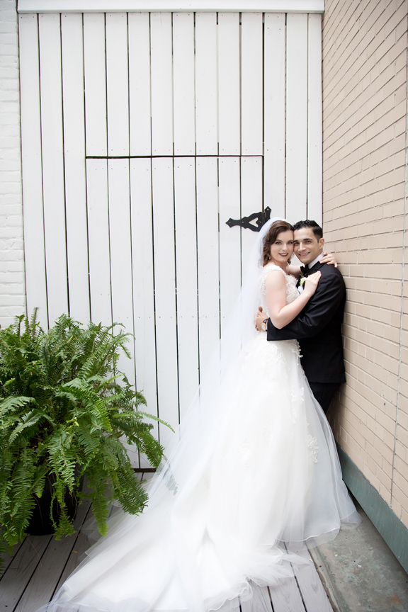 bride and groom formal portrait at Rosewater Room