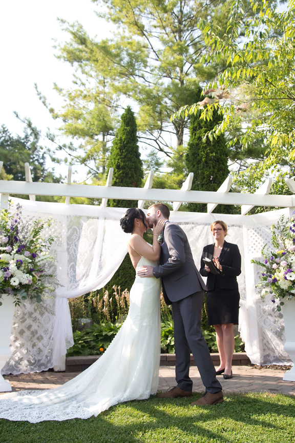 couple's first kiss wedding ceremony at Trillium Trails Banquet Centre