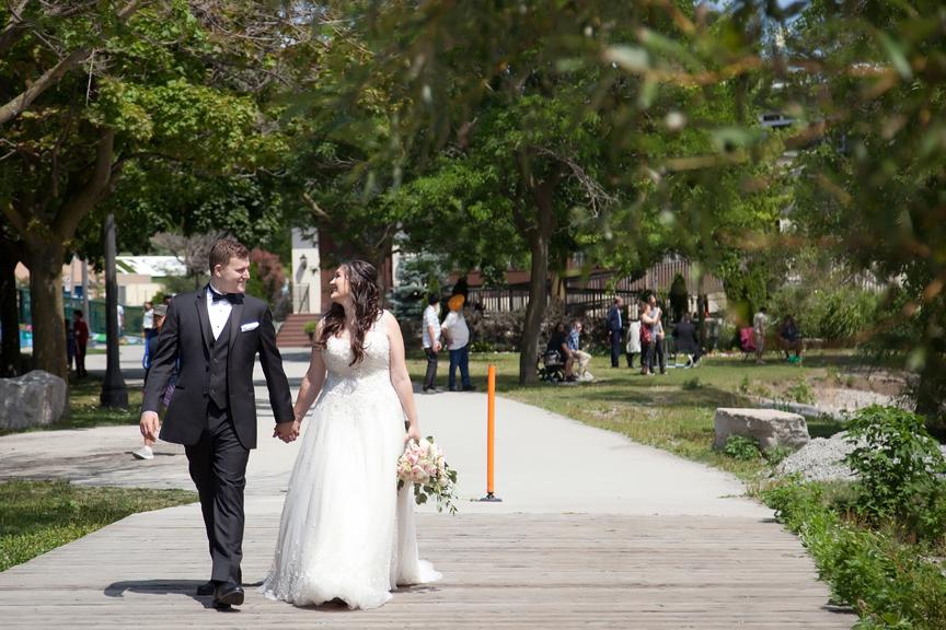 walking couple wedding portraits along waterfront