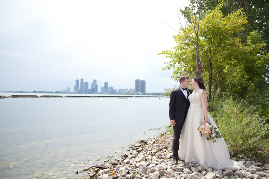 bride and groom wedding portraits along waterfront