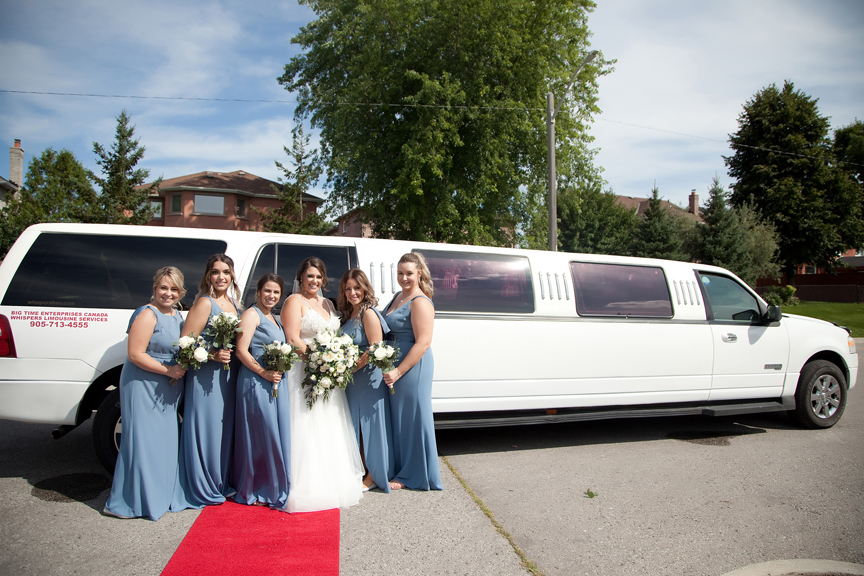 bridesmaids with limo