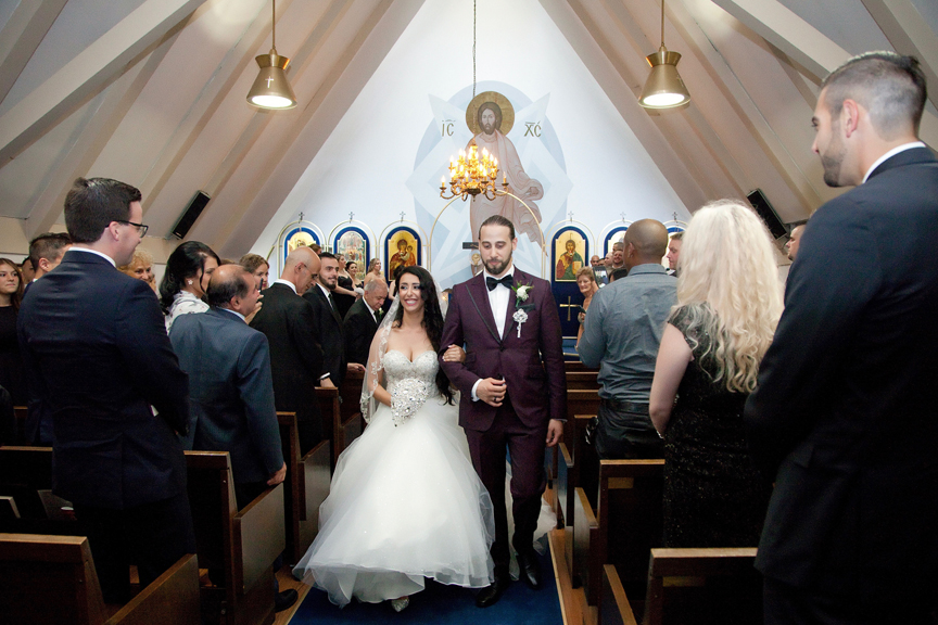 recession wedding ceremony at All Saints Greek Orthodox Church