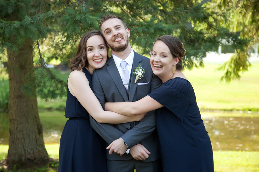 groom with sisters wedding portraits