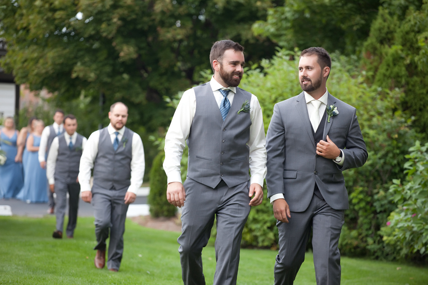 groom and best man down the aisle wedding ceremony at Paradise Banquet Hall