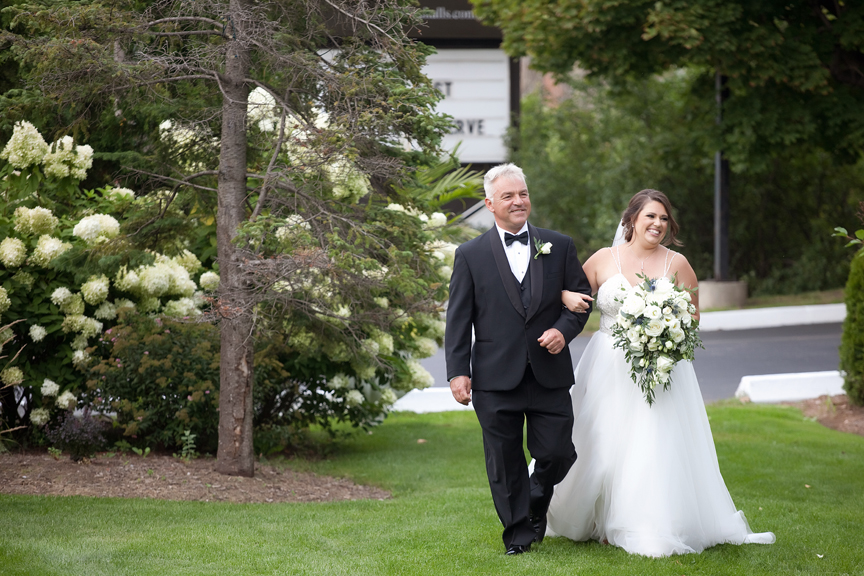 bride down the aisle wedding ceremony at Paradise Banquet Hall