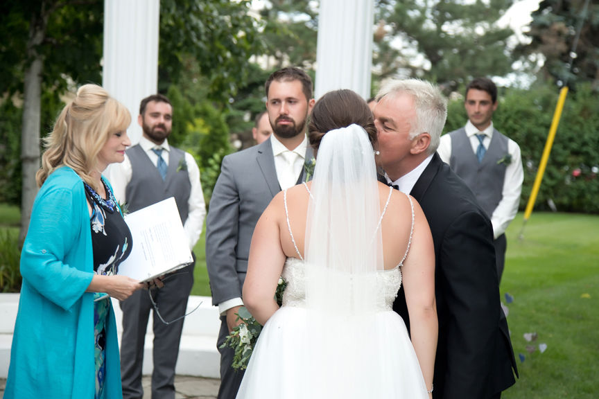 dad giving away the bride wedding ceremony at Paradise Banquet Hall