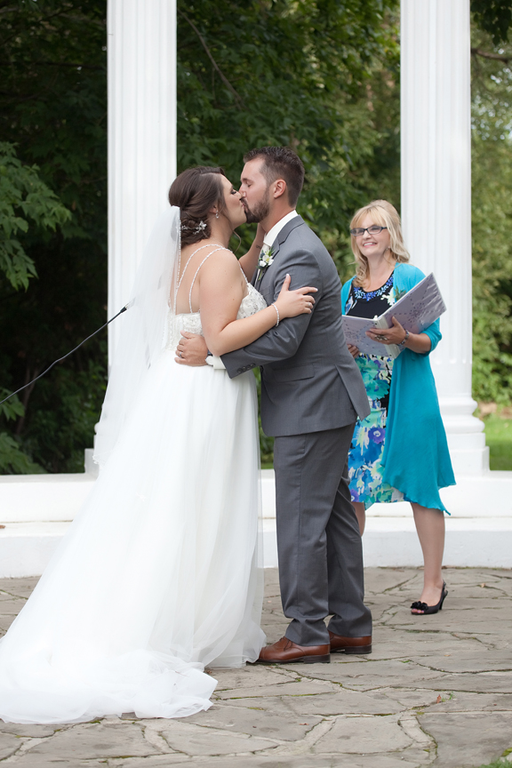 couple's first kiss wedding ceremony at Paradise Banquet Hall