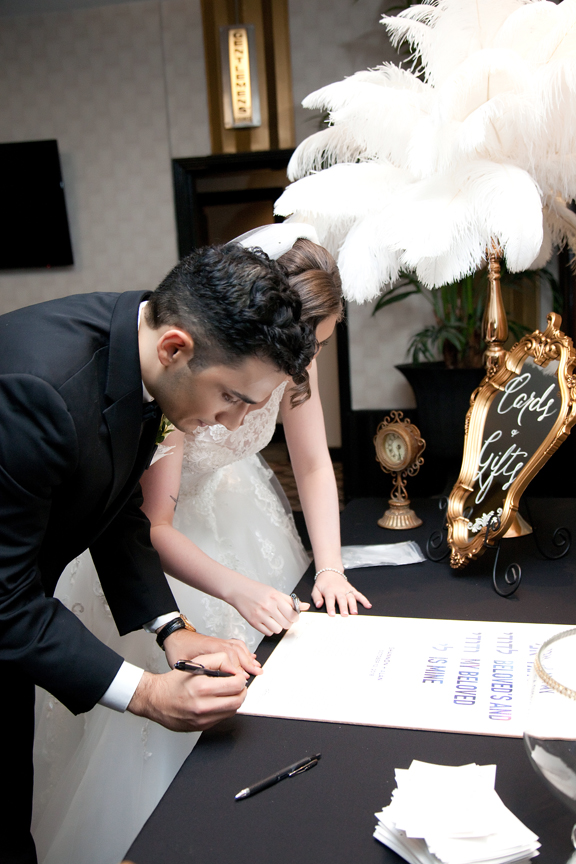 signing ketubah Jewish wedding ceremony at Eglinton Grand