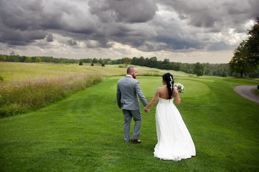 rainy day wedding couple at Tangle Creek Golf and Country Club