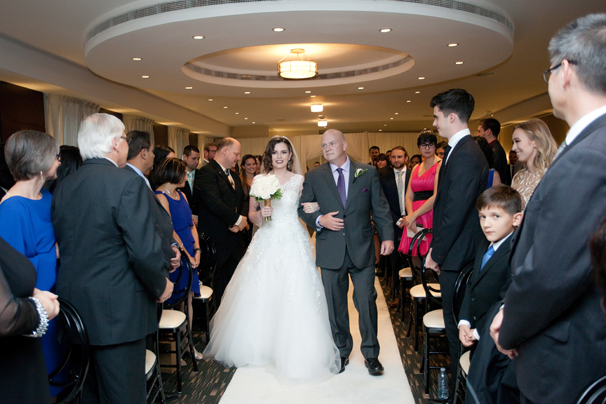 bride down the aisle Jewish wedding ceremony at Eglinton Grand