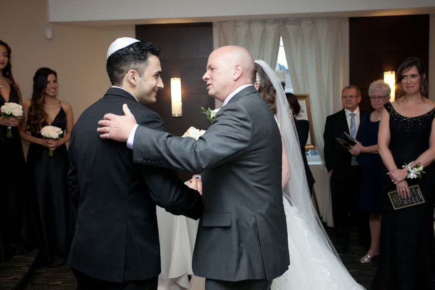 giving away the bride Jewish wedding ceremony at Eglinton Grand