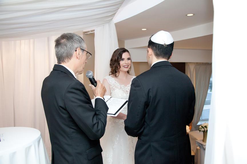 happy bride Jewish wedding ceremony at Eglinton Grand