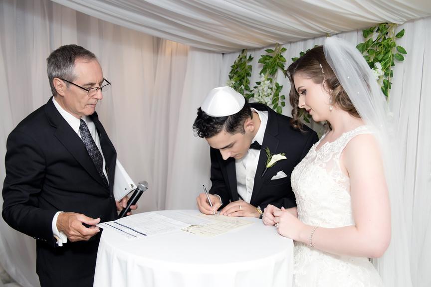 signing wedding registry Jewish wedding ceremony at Eglinton Grand
