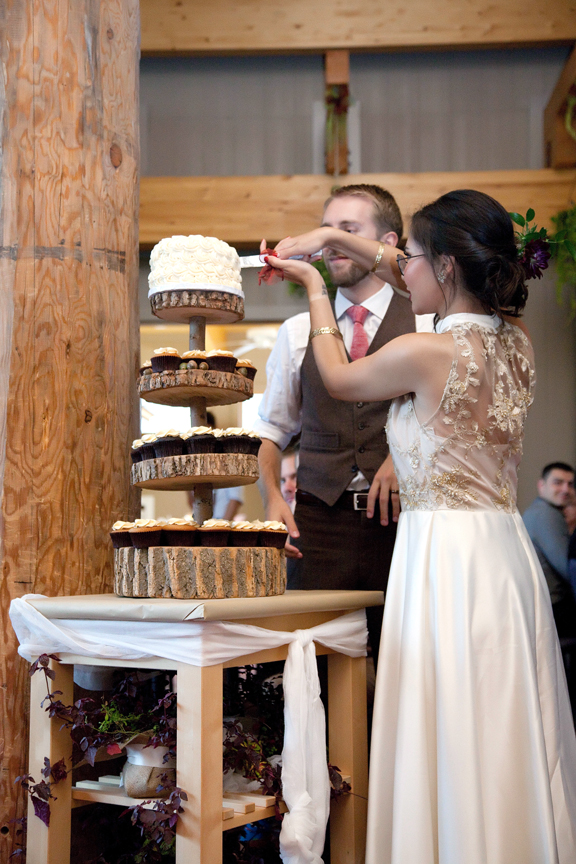 cake cutting wedding reception at Ganaraska Forest Centre